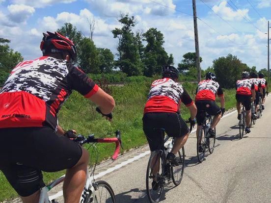 The pack sporting their red Man Up and Go jerseys as they ride en route to Cedar Falls.